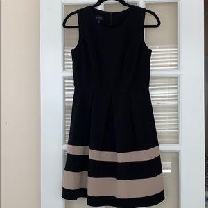 Black dress with beige stripes